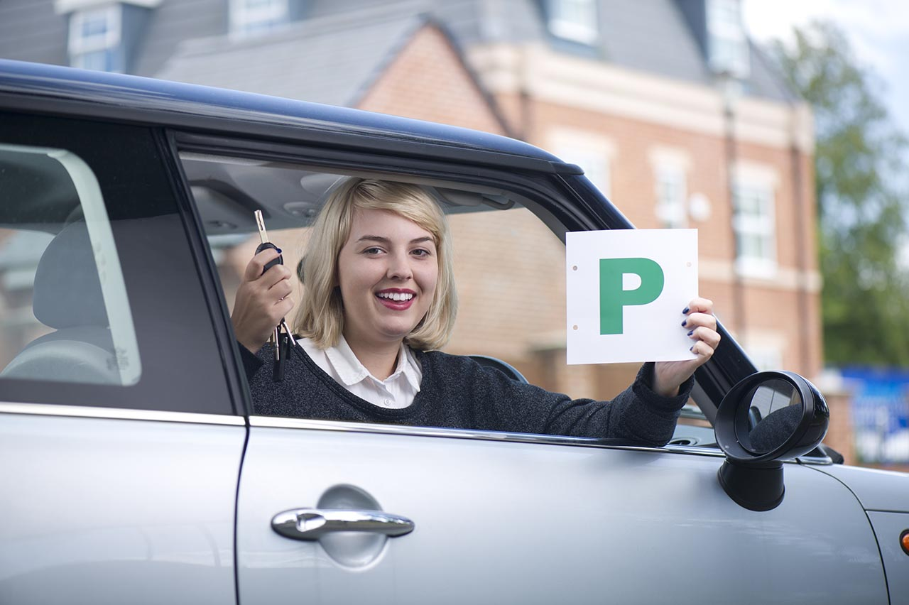 Girl holding p plates after passing her test